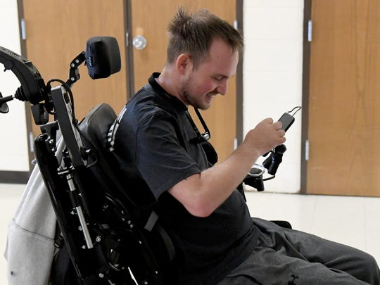 Rob Corbett smiles and is ready to get started for the day's session during his scheduled therapy session at Wilson Workforce and Rehabilitation Center on Monday, Nov. 6, 2017. A snowboarding accident last December left Corbett with a spinal injury with paralysis.