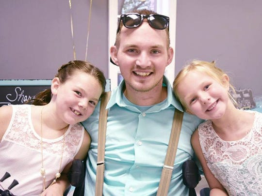 Photo of Rob Corbett with step-daughters Linley Wenger, 8, and Ashby Wenger, 7.
