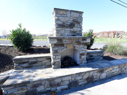 A fireplace located on the patio at The Granary at