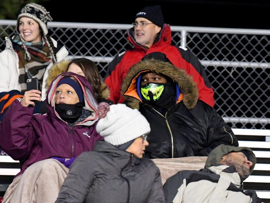 Fans are bundled up against the cold in a Region 2B