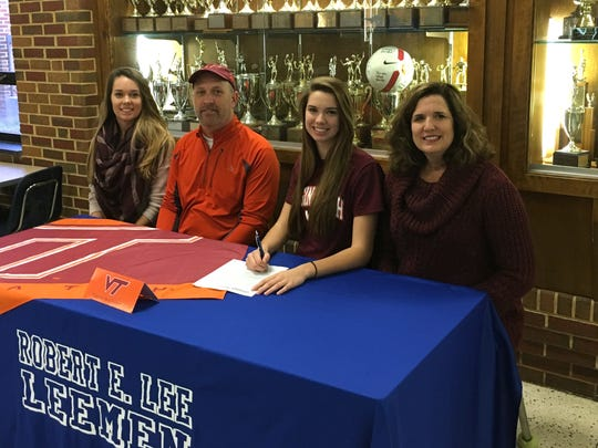 Lee High senior Jennifer Williams, second from right, will play volleyball next year at Virginia Tech. She celebrated the decision Friday afternoon at her high school with, from left, her sister, Maria Williams; father, Dwayne Williams; and mom Jan Williams.