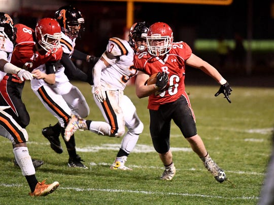 Riverheads' Dalton Jordan breaks into a run after breaking free of a tackle during a Region 1B semifinal game played in Greenville on Friday, Nov. 17, 2017.