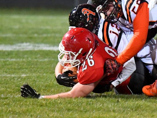 Riverheads' Dalton Jordan goes down with the ball under a pile of Altavista defenders during a Region 1B semifinal game played in Greenville on Friday, Nov. 17, 2017.
