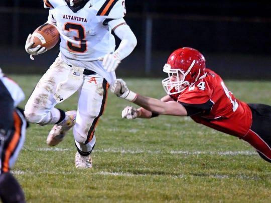 Riverheads' Jaden Phillips gets a grip on Altavista's Johnathan Montague's shirt as he tries to stop the ball carrier during a Region 1B semifinal game played in Greenville on Friday, Nov. 17, 2017.