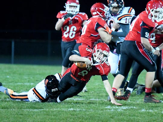 Riverheads' Zac Smiley is brought down by Altavista's Jonta Goard during a Region 1B semifinal game played in Greenville on Friday, Nov. 17, 2017.