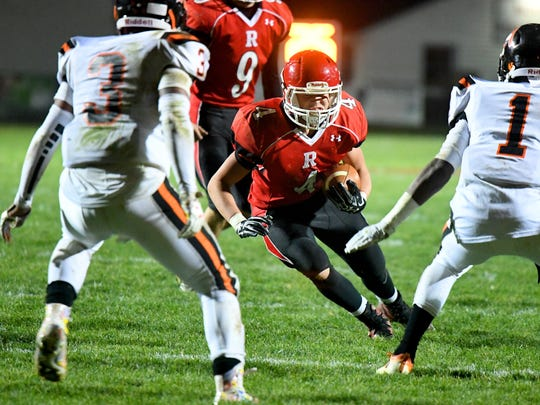 Riverheads' Blake Smith has the football as he faces Altavista's Johnathan Montague and Jacob Adams during a Region 1B semifinal game played in Greenville on Friday, Nov. 17, 2017.