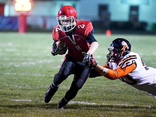 Riverheads' Devin Morris keeps running the ball as an Altavista defender snags him by the jersey during a Region 1B semifinal game played in Greenville on Friday, Nov. 17, 2017.