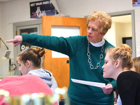 Teacher Jo Fields works with her students during a