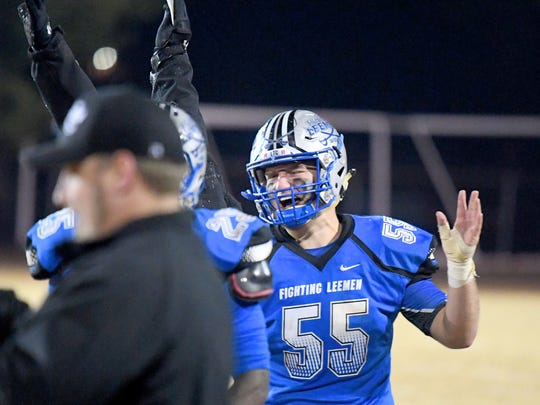 Robert E. Lee's Jack Coyner celebrates with teammates