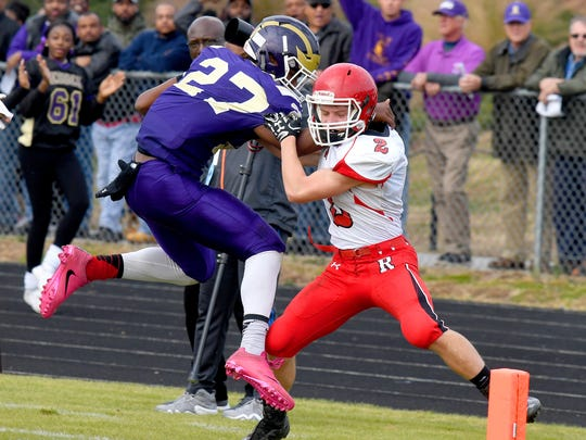 Riverheads' Devin Morris keeps Essex's Ricardo Henson out of the end zone and forces him out of bounds during a Class 1 state semifinal football game played in Saluda on Saturday, Dec. 2, 2017.