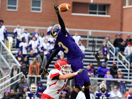 Riverheads' Blake Smith keeps Essex's Delontae Norman from catching a long pass during the VHSL Class 1 state semifinal in December 2017.
