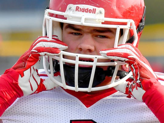 Riverheads' Forrest Shuey adjusts his helmet before