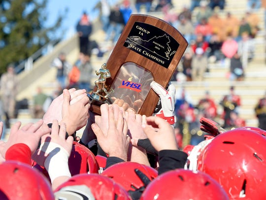 As a team, Riverheads' players and coaches hold high