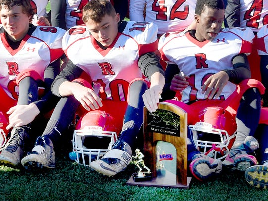 Riverheads' Jakob King reaches down to touch the Group