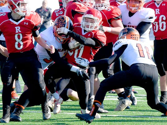 Riverheads' Jackson Shover tries to break free of a tackle as he runs the ball during the VHSL Class 1 state championship in Salem on Sunday, Dec. 10, 2017. Riverheads defeated Chilhowie, 42-0.