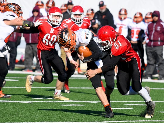 Riverheads' Ethan Hartless gets his arms around Chilhowie quarterback Zack Cale for a sack during the VHSL Class 1 state championship in Salem on Sunday, Dec. 10, 2017. Riverheads defeated Chilhowie, 42-0.