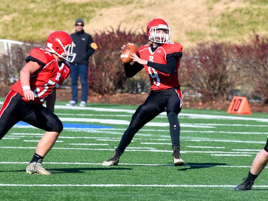 Riverheads' quarterback Tyler Smith looks to pass during