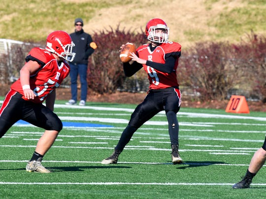 Riverheads' quarterback Tyler Smith looks to pass during the VHSL Class 1 state championship in Salem on Sunday, Dec. 10, 2017. Riverheads defeated Chilhowie, 42-0.