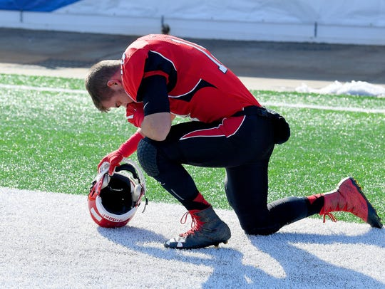 Riverheads' Forrest Shuey takes a knee for a quick