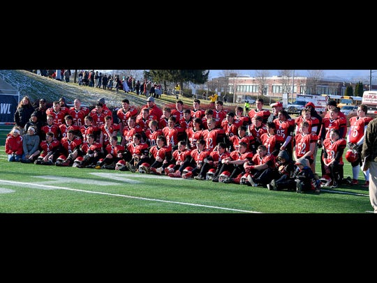 Riverheads' players pose for a team photo after they