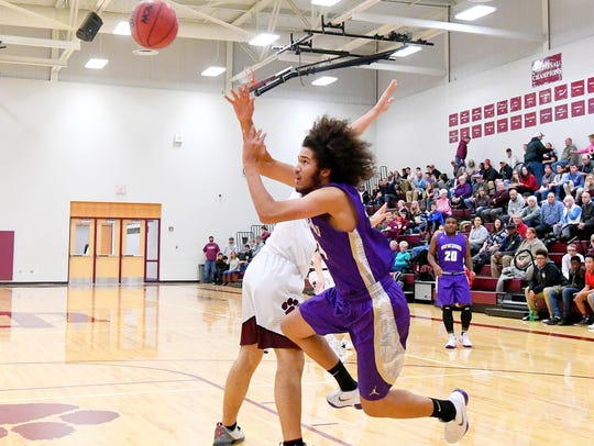 Waynesboro's Damien Fisher goes down as he shoots during