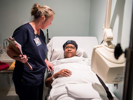 Stephanie Dyson, RN, checks on patient Deborah Frierson at Nashville General Hospital in Nashville, Tenn., Tuesday, Dec. 12, 2017.  The Metro Nashville Hospital Authority board met Thursday to discuss ongoing financial woes at the cash-strapped safety net hospital.