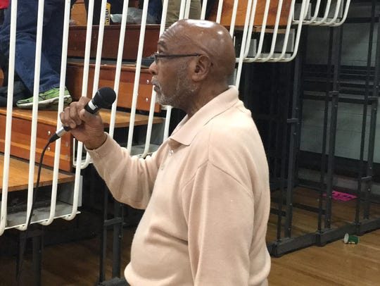 Ernest Holley sings the national anthem before most