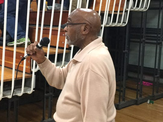 Ernest Holley sings the national anthem before most of Robert E. Lee's home boys basketball games.