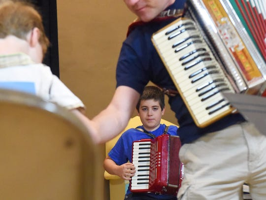 Camp participant Bennett Kricorian, 11, practices with