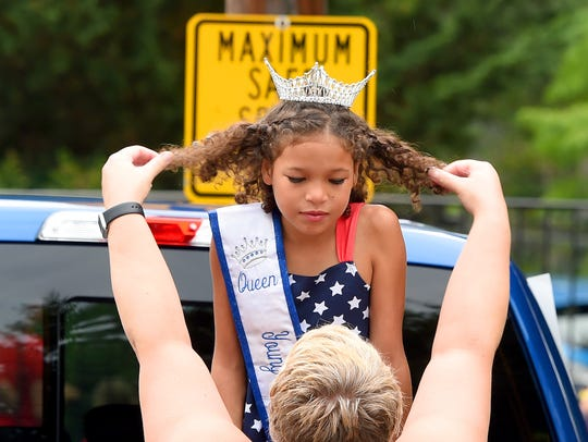Young Miss Augusta County Fair, Mia Cook, receives