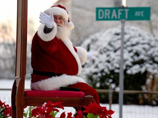 Santa Claus waves to the crowd during the Stuarts Draft Christmas parade on Saturday, Dec. 9, 2017.