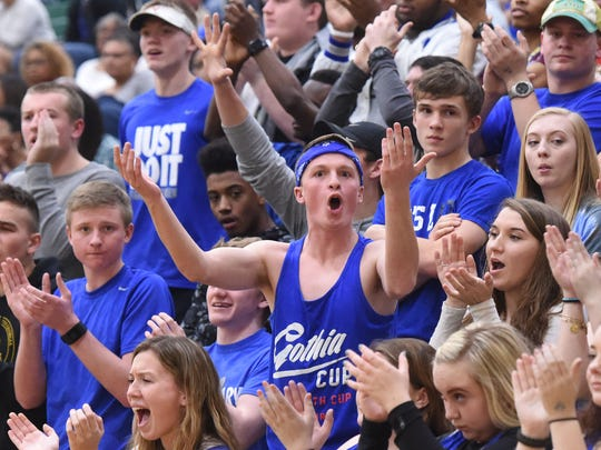 "A Robert E. Lee fan signals ""bring it on"" after they score a basket during the Region 2A East championship game played in Mechanicsville on Saturday, Feb. 25, 2017."