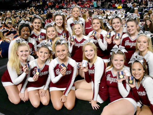 Stuarts Draft's competition cheerleaders show off their gold medals after winning the Class 2 state title at the VHSL Cheer Championships on Saturday, Nov. 4, 2017, at the Siegel Center in Richmond, Va.