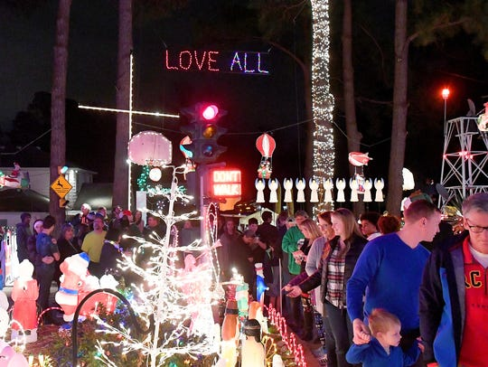 People visit the holiday lights and decorations at