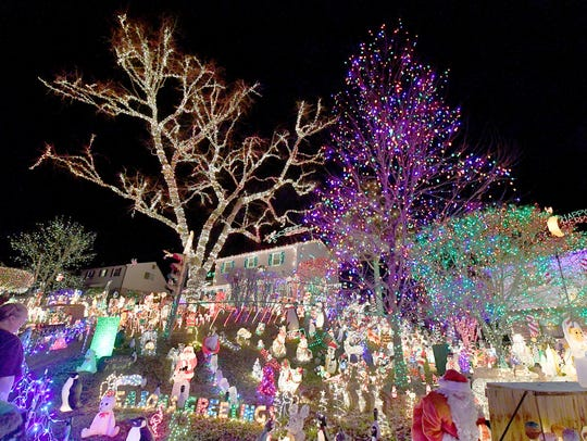 Thousands of lights illuminate the trees at 9604 and 9606 Asbury Court in Henrico.