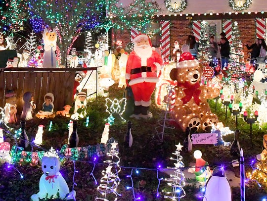 """Holiday lights and decorations of all types fill the lawns in front of both houses at 9604 and 9606 Asbury Court in Henrico. Since 1974, the holiday lights of """"A Phifer Christmas"""" have been lighting up the holidays in the Richmond area."""