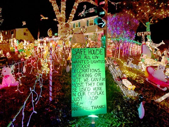 """A sign lets visitors know they are a """"safe house"""" for all unwanted lighted outdoor holiday decorations. Since 1974, the holiday lights of """"A Phifer Christmas"""" have been lighting up the holidays in the Richmond area. New Year's Eve will be the last chance to see them this season."""