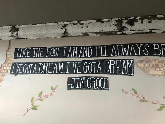 """Lyrics from the late singer-songwriter Jim Croce's top 10 hit, """"I Got a Name"""" are painted on the wall of The Crafted Bean coffee shop at 800 E. Michigan Ave. in Lansing."""