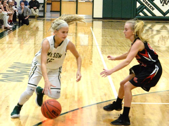 Wilson's LeAnna Rankin tries to get around an East