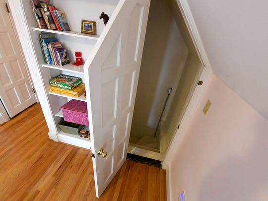 Hidden stairs that lead down to the play room from