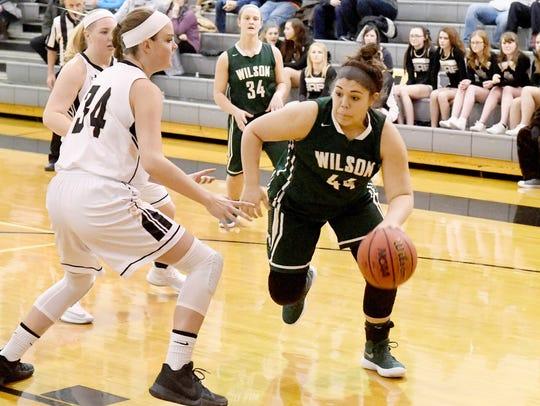 Wilson Memorial's Sarah Sondrol takes the ball past