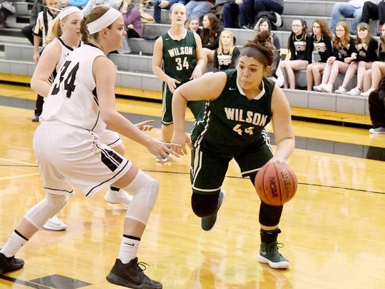 Wilson Memorial's Sarah Sondrol takes the ball past Buffalo Gap's Brittney Hanger as she tries to reach the basket during a basketball game played in Swoope on Friday, January 5, 2018.