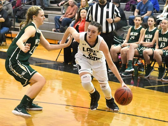 Buffalo Gap's Leah Calhoun drives the ball around Wilson Memorial's Paris Hutchinson during a basketball game played in Swoope on Friday, January 5, 2018.