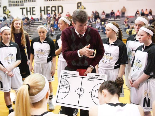 Buffalo Gap head coach Phillip Morgan talks with his team just before tipoff of their game against Wilson Memorial, played in Swoope on Friday, January 5, 2018.