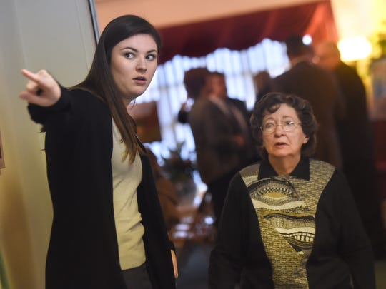 """""""It was hard to explain as a child to another child,"""" said Emma Keffer, left, of talking to some of her friends while growing up in the funeral home business. Keffer is seen here, helping out during a recent service at the West Market Street funeral home."""