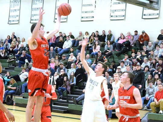 Dalton Jefferson (22), seen here pulling down a rebound against Wilson Memorial, led East Rockingham with 20 points in Saturday's win over Lee High.