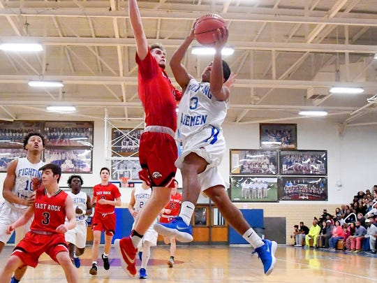 Robert E. Lee's Jayden Williams take the ball up to the basket during a basketball game played in Staunton on Tuesday, Jan. 9, 2018.
