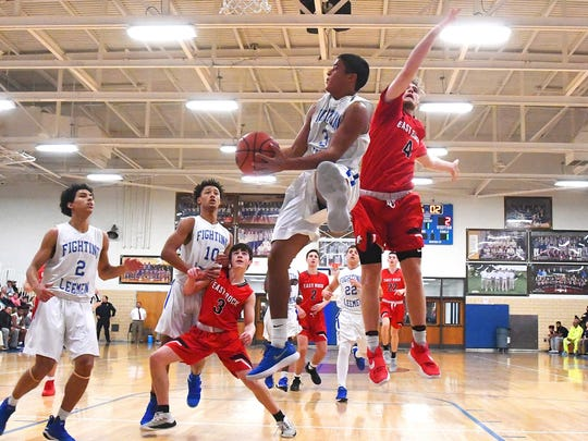 Robert E. Lee's Jayden Williams take the ball up to the basket past East Rockingham's Collin Wigley during a basketball game played in Staunton on Tuesday, Jan. 9, 2018.