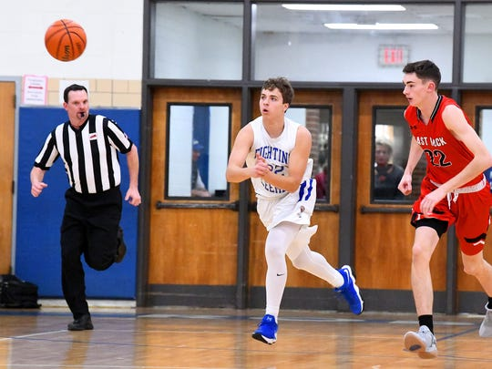 Robert E. Lee's Everrett Castle passes the ball during a basketball game played in Staunton on Tuesday, Jan. 9, 2018.