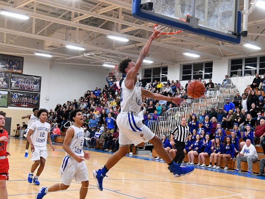 Robert E. Lee's Jarvis Vaughan slams the ball through the basket during a game played in Staunton on Tuesday, Jan. 9, 2018.